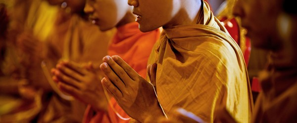 Buddhist monk pray for the death of people