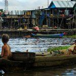 Kid rowing boat in Tonle Sap Lake