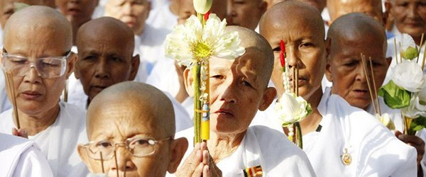 Buddhist devotees pray during Meak Bochea Day