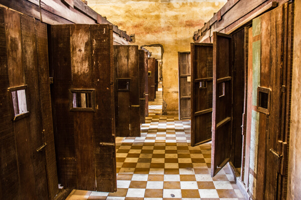 Wooden prison cells in Tuol Sleng Museum - Cambodia 14 Day Tour