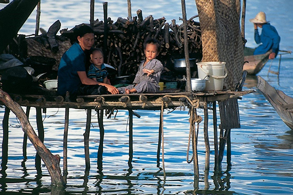 Local family of Kampong Phluk Floating Village resting in their house on Tonle Sap Lake