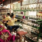 Local women weaving silk in a workshop in Angkor Silk Farm