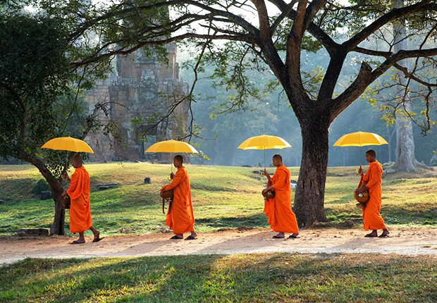 Monks in the Angkor temple of Cambodia