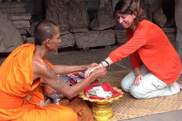 monk blessing in Ang Kor Wat, Cambodia vacations